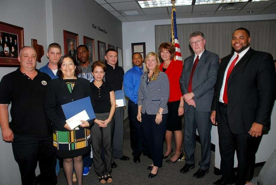 Six San Jacinto College veteran students received scholarships through the San Jacinto College Foundation. Pictured at a recent board meeting are (left to right): Gary Alston, scholarship recipient; Silvia Escobedo, scholarship recipient; Jeffrey Everitt, scholarship recipient; Willie Bush, scholarship recipient; Daisy Saenz, San Jacinto College Central Campus veteran success coordinator; Manuel Orlando Fernandez, scholarship recipient; Ricky Lynn Sistrunk, scholarship recipient; Ruth Keenan, executive director, San Jacinto College Foundation; Dr. Brenda Hellyer, Chancellor, San Jacinto College; Dr. Bill Raffetto, interim provost, San Jacinto College; and Eugene Bernard, San Jacinto College South Campus veteran success coordinator. Photo: Amanda L. Booren