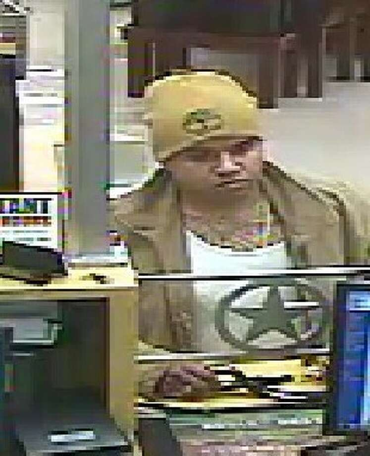 Surveillance footage of the man who robbed a First Convenience Bank in Houston, Sunday. Photo: FBI Houston Press Office
