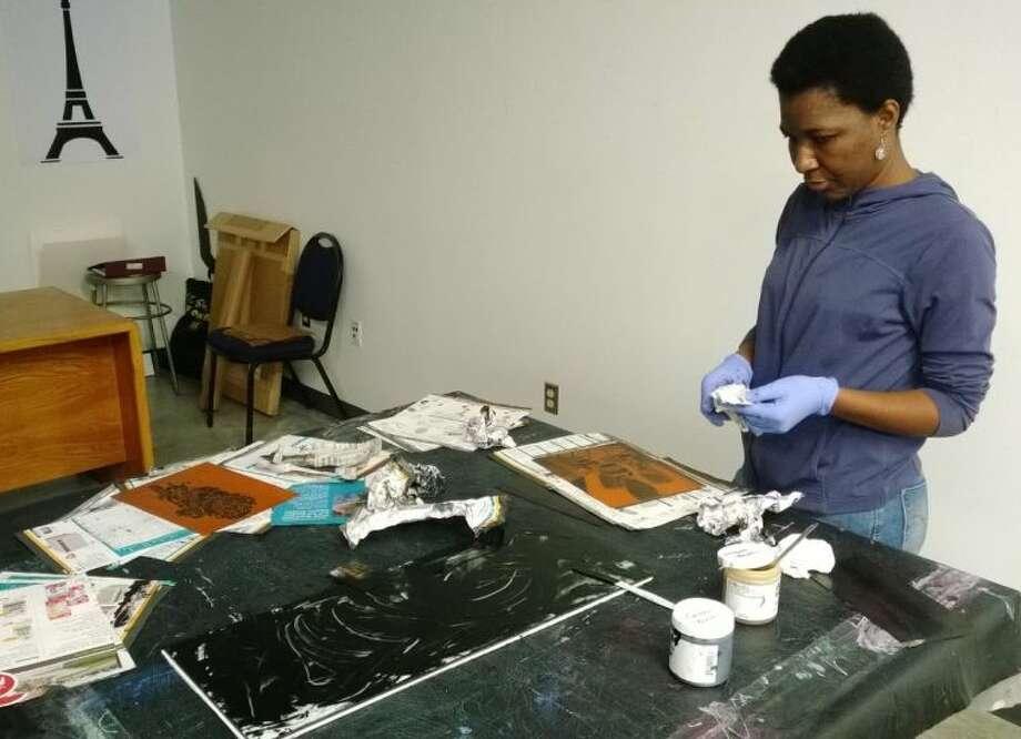 Carine Touko inks her plate. Photo: Cyrus Karami