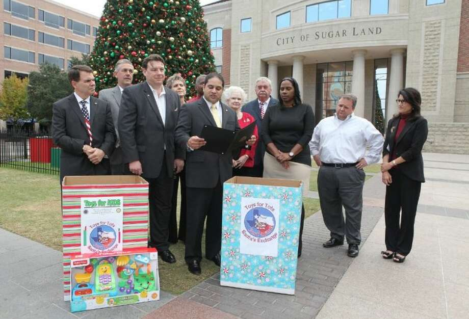 Sugar Land City Councilmember Himesh Gandhi reads a proclamation during a Toys for Tots and Santa's Exchange press conference at Sugar Land Town Square on Wednesday, Nov. 20. Toys for Tots, The Exchange Club of Sugar Land, Sugar Land Rotary and The Exchange Club of Fort Bend have partnered to provide toys for over 5,000 Fort Bend County children this Christmas. Photo: Alan Warren