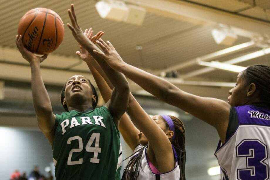 Dominique Harrison (24) is fouled as she shoots during Kingwood Park's win over Humble on Tuesday. Photo: ANDREW BUCKLEY