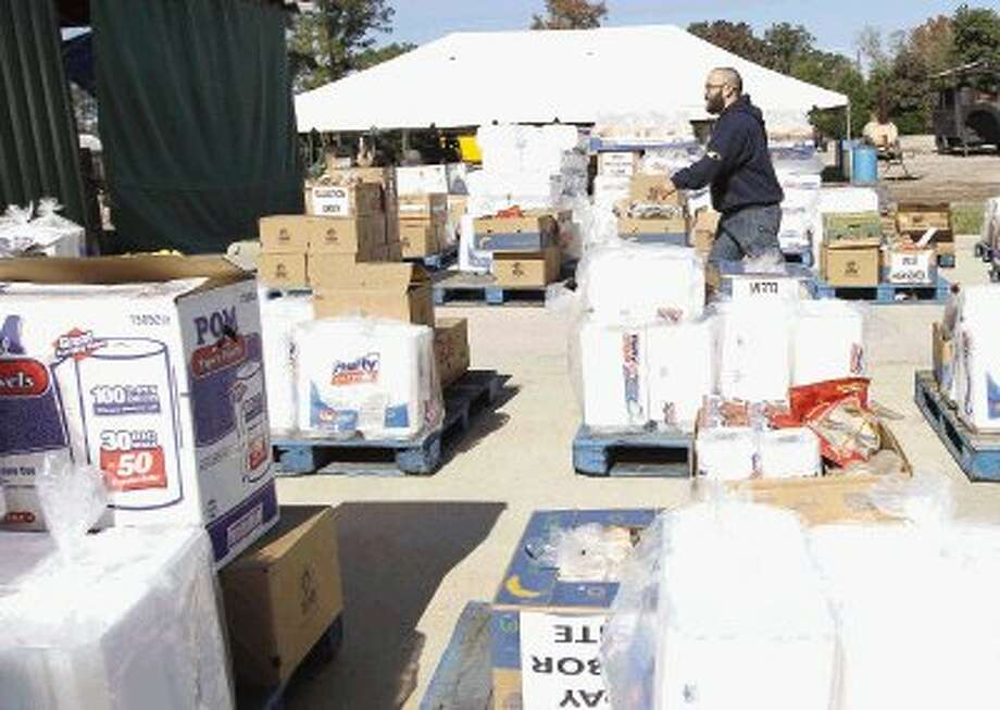 The Ark Church volunteers get supplies ready for today's Thanksgiving meal in Conroe. Organizers estimate 14,000 people will receive a hot meal today at more than 30 locations in Montgomery County. Photo: Staff Photo By Jason Fochtman / Jason Fochtman