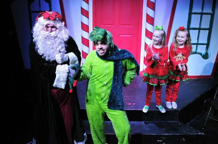 "From left, Santa (J. D. Mathis from Deer Park) and the Ol' Meanie (Aaron Alford from Orange) are congratulated for becoming friends by Little Cindy and Lu Whom (Caitlynn and Sarah Ivins, guest artists from Deer Park) in a scene from San Jacinto College's production of ""Santa's Christmas Magic, the musical."" Photo: ROB VANYA"