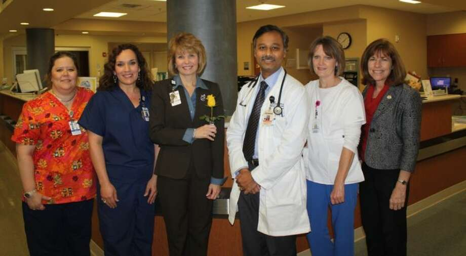 Kingwood Medical Center's ICU Nurses Laura Holder and Kristil Wright with CEO Melinda Stephenson, Donate Life Physician Champion Dr. Turuvekere Jayaram, ICU Nurse Wanda Alsbrook, and Life Gift Specialist Denise Van Kuiken, provide a personalized message of hope attached to a rose vial that will adorn the Donate Life Rose Parade Float on New Year's Day.