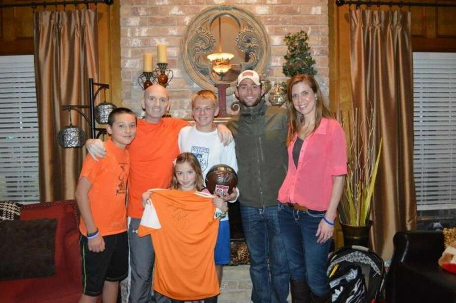 Houston Dynamo soccer player Brad Davis, in the hat, made a surprise visit to the Luna family in Kingwood. Patrick, who recently lost his battle to a rare, aggressive form of cancer, and his family had a surprise as Davis, visited their house with a signed jersey and ball for their oldest son, Connor who plays high school soccer and it just lifted everyone's spirits so much.