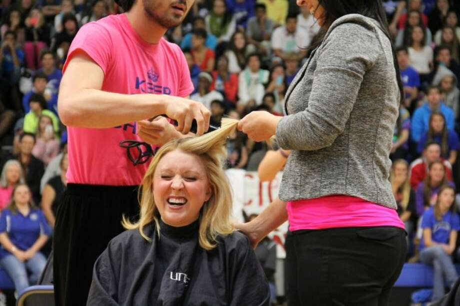 Tne Clear Springs High School Student Council recently organized the Follicle Frenzy Project that raised more than $10,000 to help a family in need. Photo: Submitted Photo