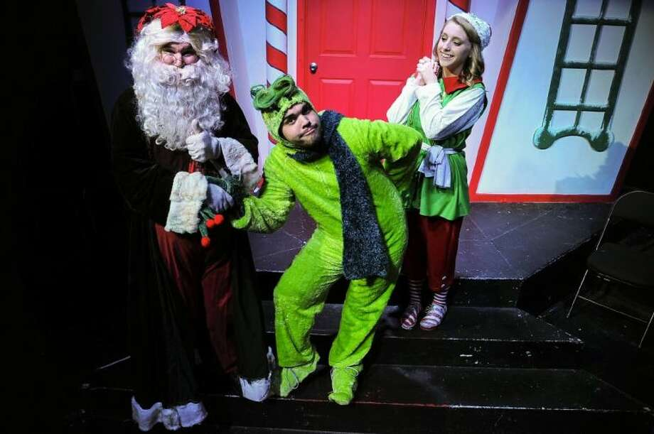 "From left, Santa (J. D. Mathis from Deer Park) and the Ol' Meanie (Aaron Alford from Orange) are congratulated for becoming friends by an Elf (Laurenn Reynolds from Friendswood) in a scene from San Jacinto College's production of ""Santa's Christmas Magic, the musical."" Photo credit: Rob Vanya, San Jacinto College marketing, public relations, and government affairs department."