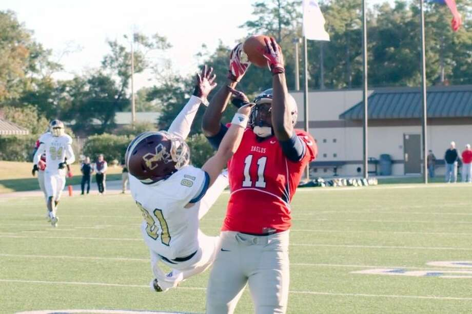 Dawson's Tony Upchurch (11) makes a catch over Magnolia West's Trent Parsons (81) Friday. Upchurch had four catches for 122 yards, including a 77-yard TD reception from Ross Wicklund. Photo: KIRK SIDES