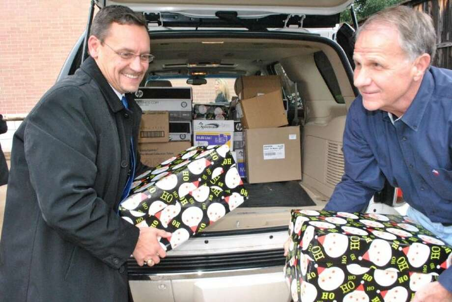 Congressman Ted Poe, right, drops off thousands of cards for troops overseas. This year the community combined for a record-breaking 110,500 Christmas cards that will be delivered to troops overseas before Christmas Day.