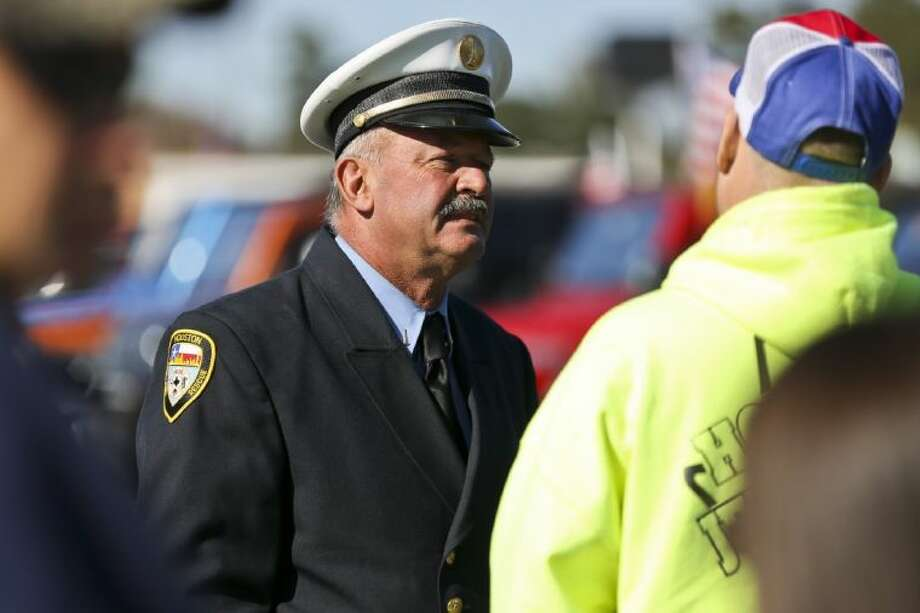 Captain Joe Kovalchik, HFD retired, speaks with another participant of Captain Dowling's Welcome Home on Wednesday Nov. 27 in a parking lot at Interstate 45 and FM 2920. More than 50 Jeeps and trucks from several Jeep clubs throughout Houston showed up to support Captain Bill Dowling, Houston Fire Department, as he was released from Memorial Hermann Texas Trauma Institute on Wednesday. (Michael Minasi / HCN) Photo: Michael Minasi