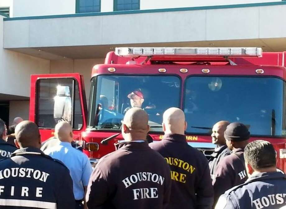 Firefighters support Captain Bill Dowling as he leaves Memorial Hermann Texas Trauma Institute on Wednesday Nov. 27 in Engine 68.