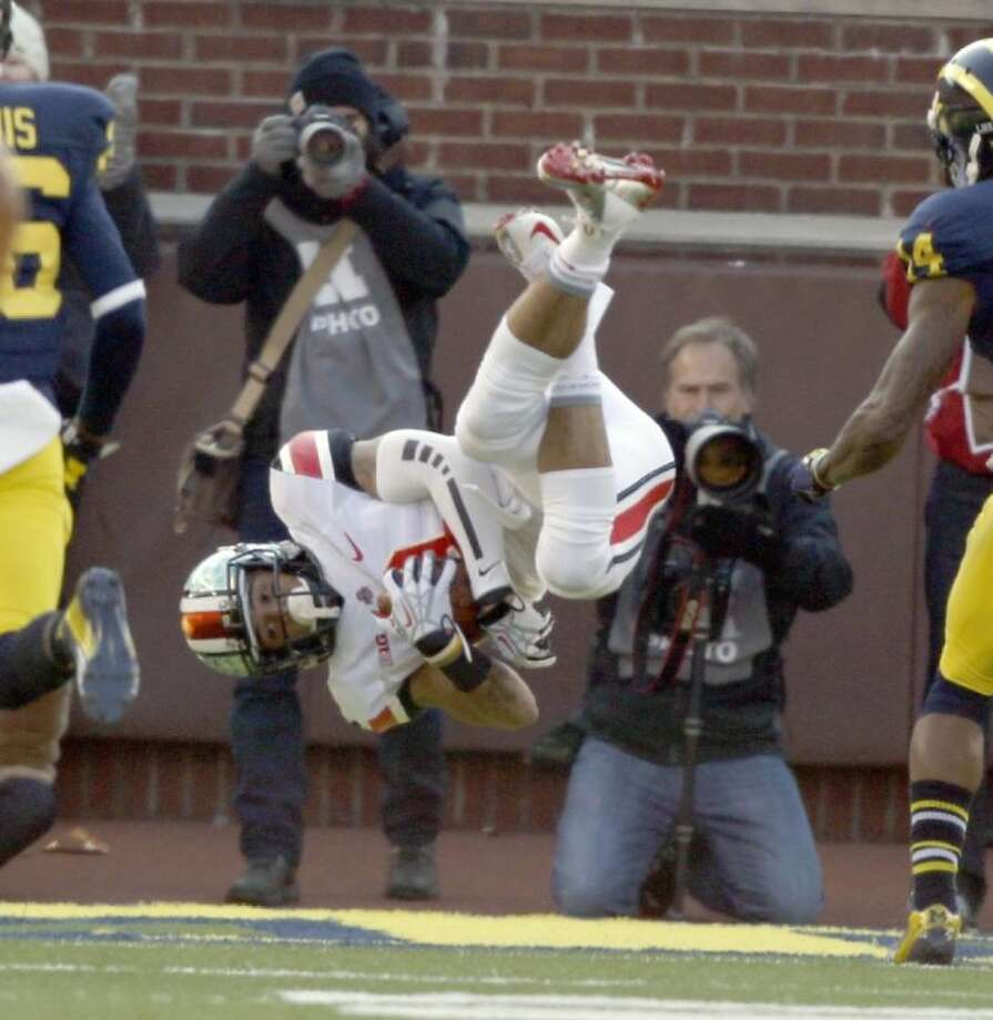 Ohio State's Devin Smith barrel rolls into the end zone for a touchdown against Michigan. Ohio State won 42-41.