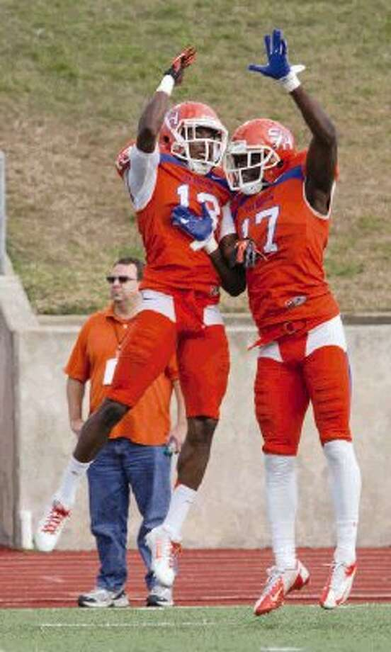 Sam Houston State cornerbacks DeAntrey Loche (13) and Bookie Sneed (17) celebrate during Saturday's FCS playoff game against Southern Utah at Elliott T. Bowers Stadium. Sneed is a Conroe High School graduate. To view or purchase this photo and others like it, visit HCNpics.com. / The Conroe Courier/ The Woodland