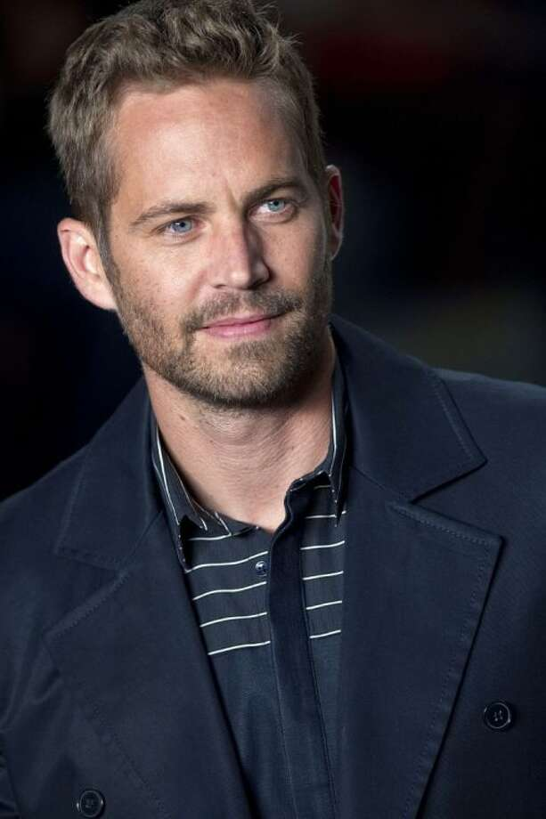 "File-This March 21, 2013 file photo shows actor Paul Walker wearing a creation from the Colcci summer collection at Sao Paulo Fashion Week in Sao Paulo, Brazil. A publicist for actor Walker says the star of the ""Fast & Furious"" movie series has died in a car crash north of Los Angeles. He was 40. Ame Van Iden says Walker died Saturday, Nov. 30, 2013. No further details were released. (AP Photo/Andre Penner, File) Photo: Andre Penner"