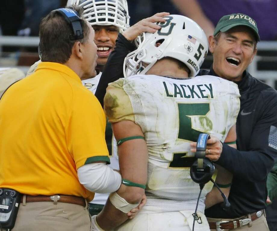 Baylor coach Art Briles, right, greets linebacker Eddie Lackey during the Bears' victory over TCU.