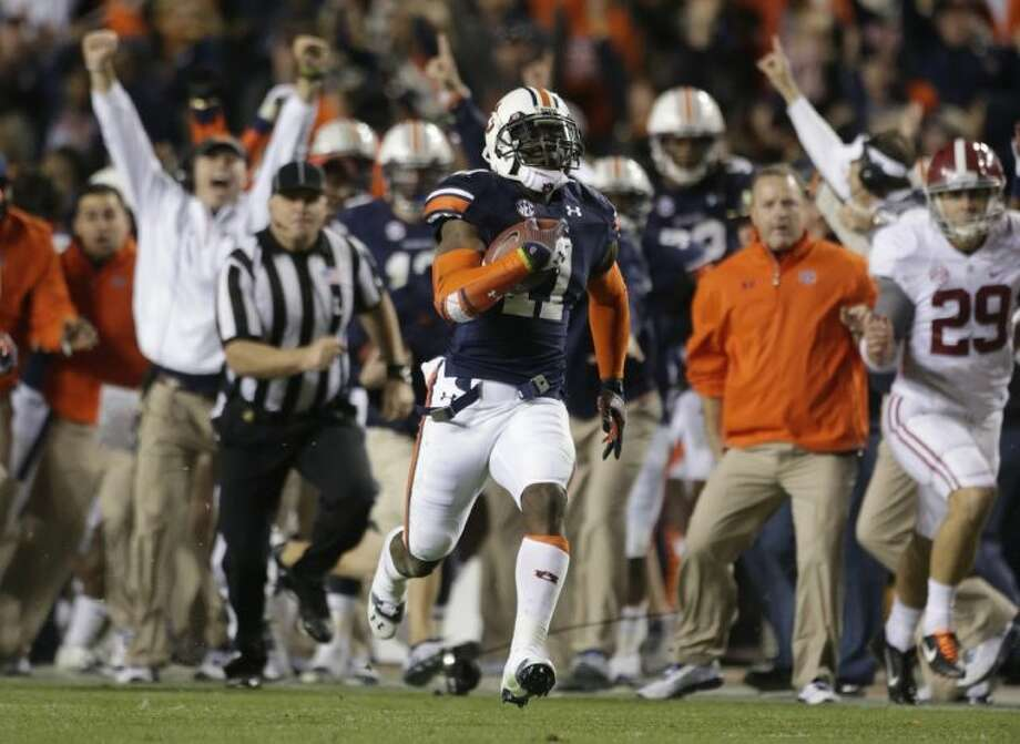 Auburn's Chris Martin returns a missed field goal for the winning score in the Tigers' 34-28 victory over Alabama.