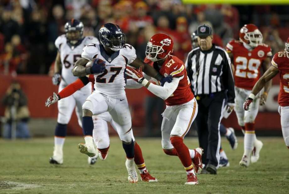 Broncos running back Knowshon Moreno (27) runs against Chiefs cornerback Sean Smith in the second half. The Broncos won 35-28.