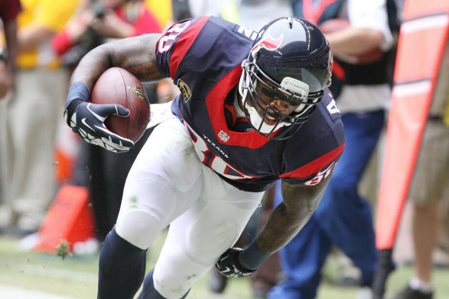 Houston's Andre Johnson tries to stay in bounds as he fights for the endzone against New England after catch during game at Reliant Stadium in Houston on Sunday, December 1, 2013. (Photo by Alan Warren) Photo: Photo By Alan Warren