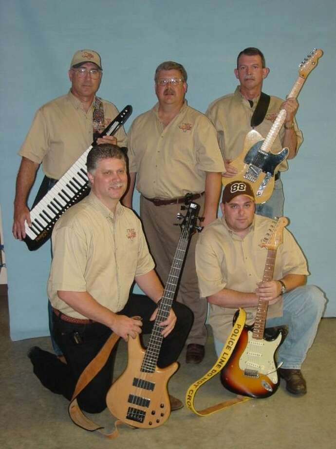 The Crimestoppers Band is comprised of members of the Lufkin Police Department. The band will be performing at Christmas on the Square on Dec. 14 in Coldspring. Photo: Submitted Photo