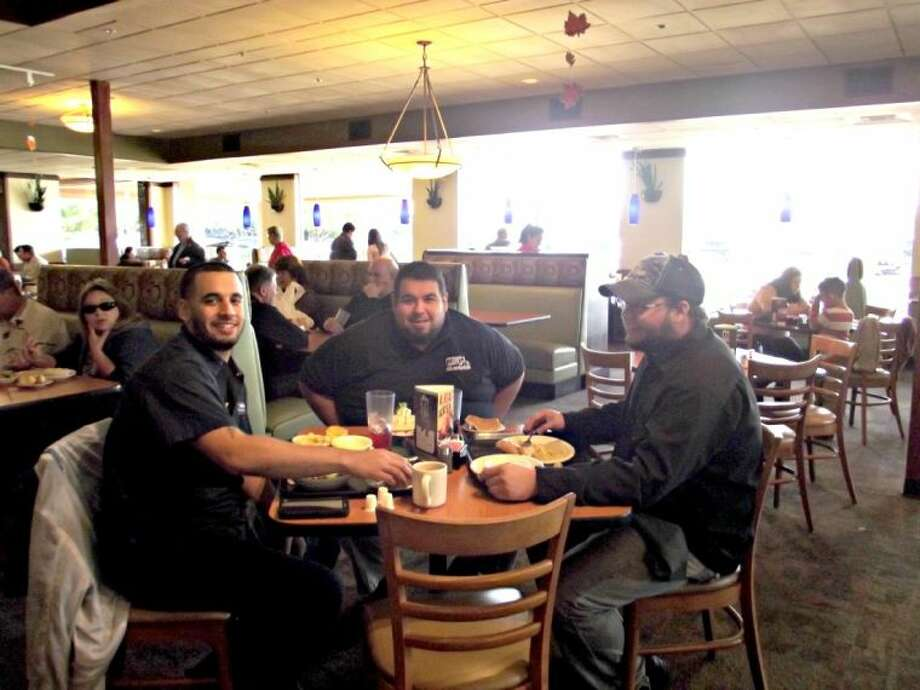 UTI students enjoy a free Thanksgiving dinner at Luby's in Cypress.