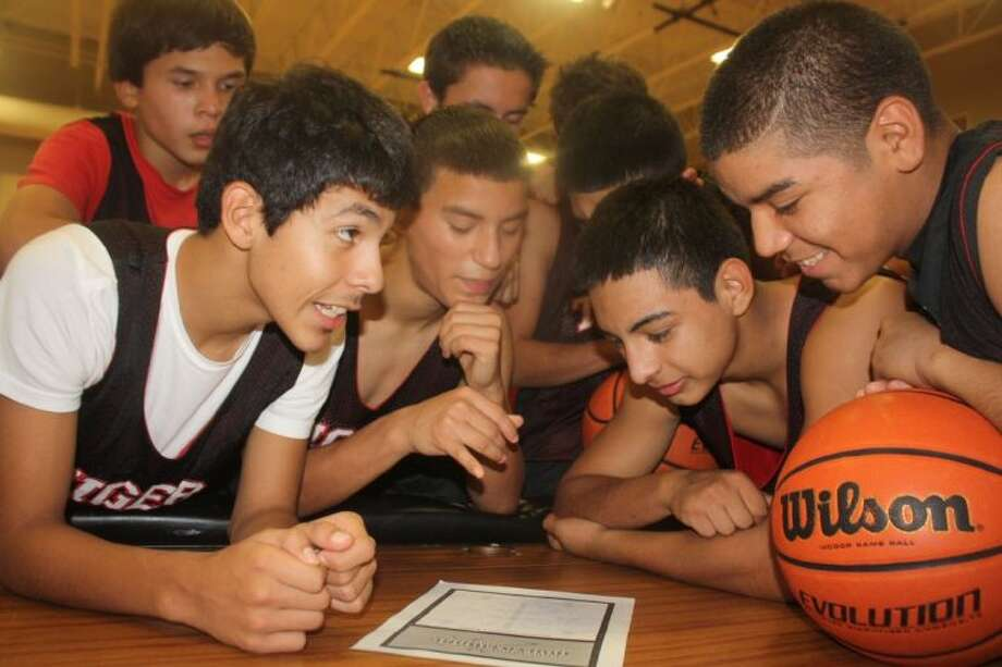 The San Jacinto Intermediate School eighth grade A team analyzes the bracket for this weekend's 9th annual San Jacinto Invitational. Their coach lists Nolan Ryan Junior High as the favorites going in. Photo: Robert Avery
