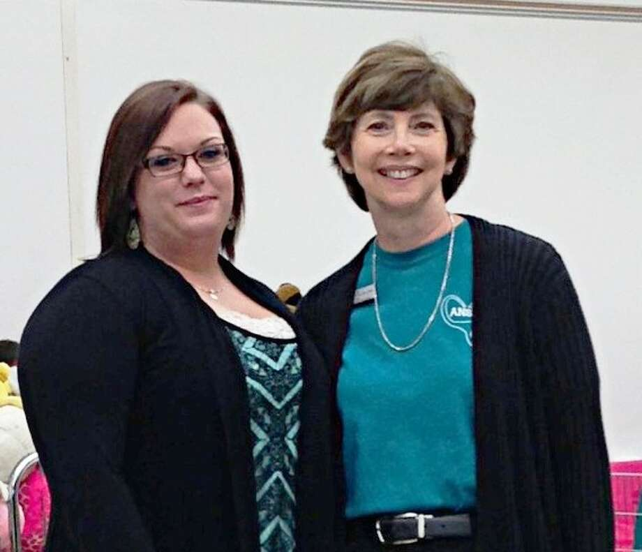 Brandie Bowman, left, receives a $500 Dickie Lee Fox Memorial Scholarship from ACC Nursing Director Sally Durand on November 20. Photo: Courtesy ACC