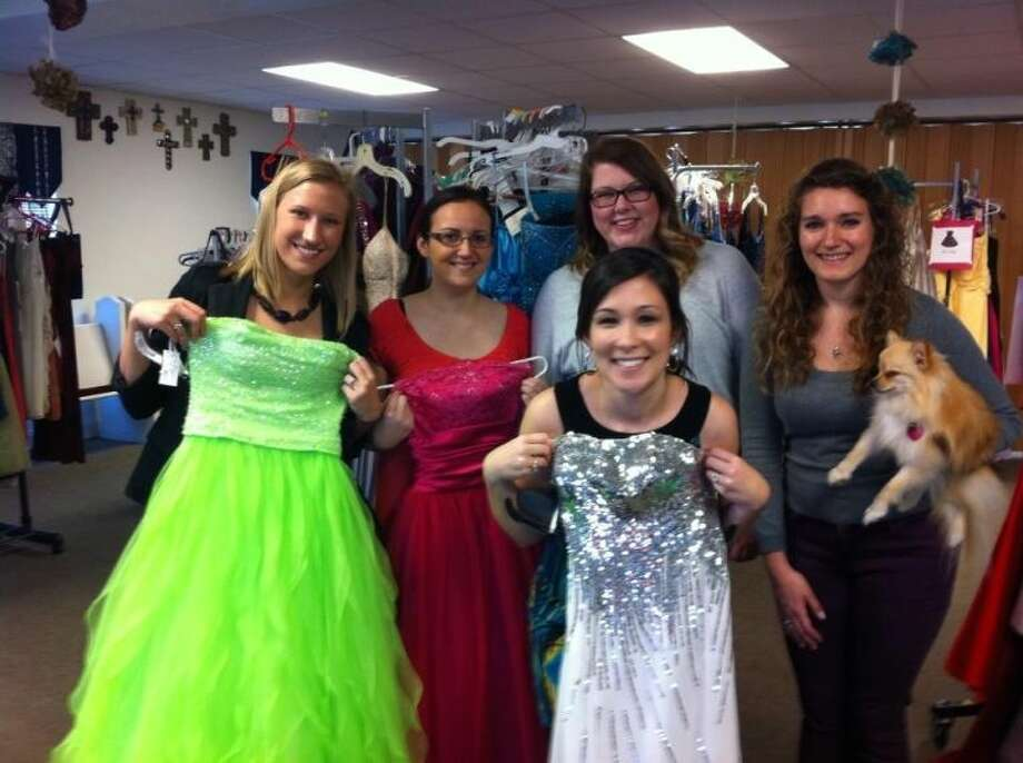 The 27 Dresses Project was held at United Methodist Church last year and got help from 15 to 20 volunteers, including Hannah Taylor, Stephanie Edwards, Emily Hargraves, Emily Kebodeaux and Jen Rumpf. Taylor and Kebodeaux began the project to help local girls receive prom dresses at a reasonable price. Photo: Submitted Photo