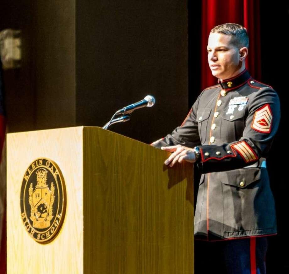 Gunnery Sgt. Brian Janisch speaks to Klein Oak students.