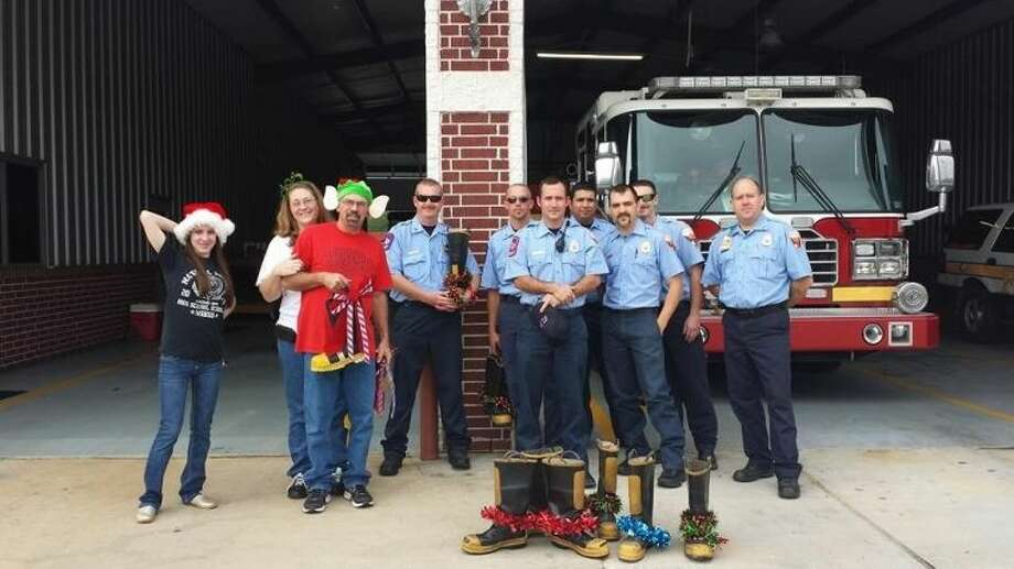 Several members of the New Caney Fire Department helped raise funds for local nonprofit Heaven's Army by holding fill-the-boot fund raisers. Photo: Submitted Photo