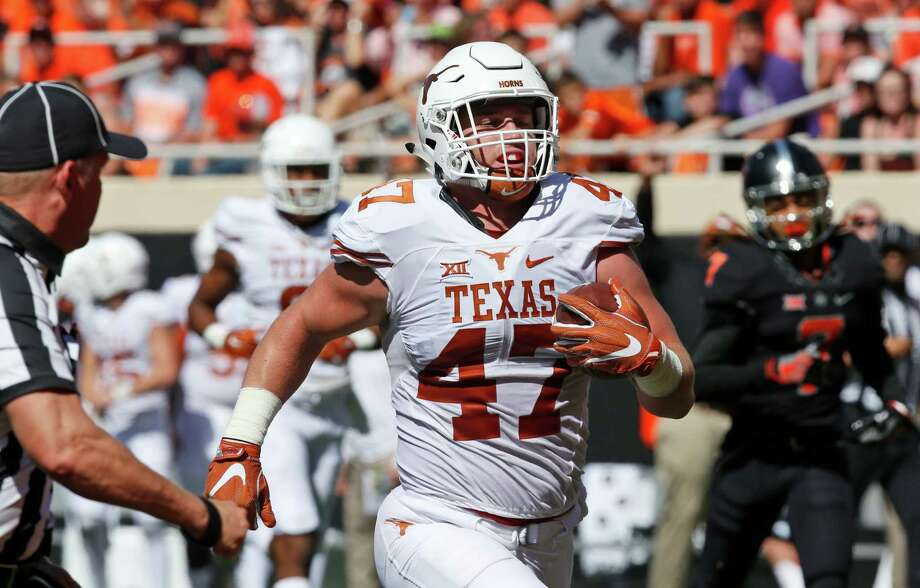Texas tight end Andrew Beck (47) runs into the end zone with a touchdown against Oklahoma State in the second quarter of an NCAA college football game in Stillwater, Okla., Saturday, Oct. 1, 2016. (AP Photo/Sue Ogrocki) Photo: Sue Ogrocki, Associated Press / AP2016