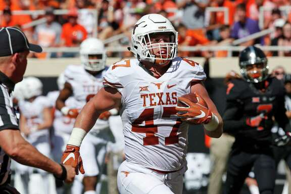 Texas tight end Andrew Beck (47) runs into the end zone with a touchdown against Oklahoma State in the second quarter of an NCAA college football game in Stillwater, Okla., Saturday, Oct. 1, 2016. (AP Photo/Sue Ogrocki)