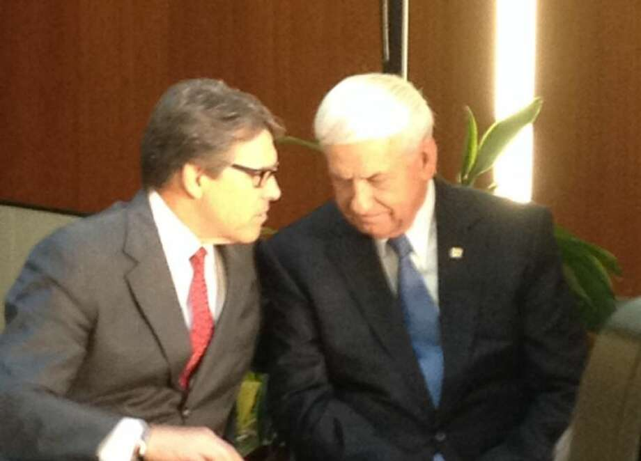 From left: Gov. Perry and GEICO CEO Tony Nicely. GEICO announced the opening of a new claims office in Katy, Monday, Dec. 2. Photo: Alex Endress