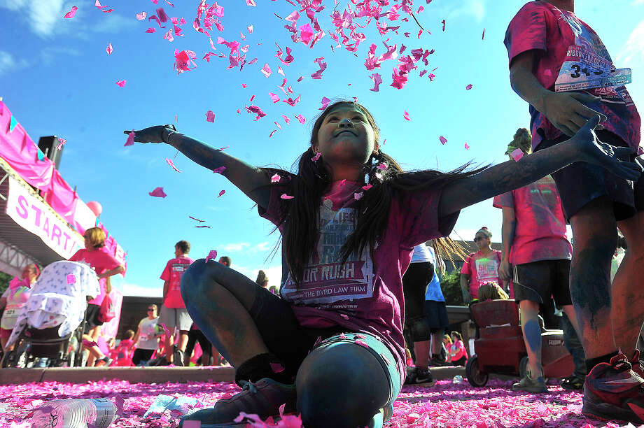 Hazel Castellano, 9, smiles as she tosses confetti in the air after finishing the 5K with family during the Gift of Life's 6th annual Julie Richardson Procter 5K Ribbon Run Color Rush Saturday in downtown Beaumont. Photo taken Saturday, October 1, 2016 Kim Brent/The Enterprise Photo: Kim Brent / Beaumont Enterprise