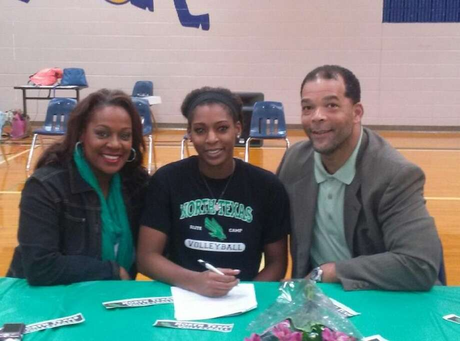 Elkins senior Bailey Banks signed a volleyball scholarship with the University of North Texas, celebrating the achievement with her family at Elkins High School. Photo: Submitted Photo