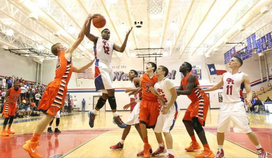 Oak Ridge's Joshua Caldwell (12) grabs a rebound during a high school boys basketball game at Oak Ridge High School Tuesday. To view or purchase this photo and others like it, visit HCNpics.com.