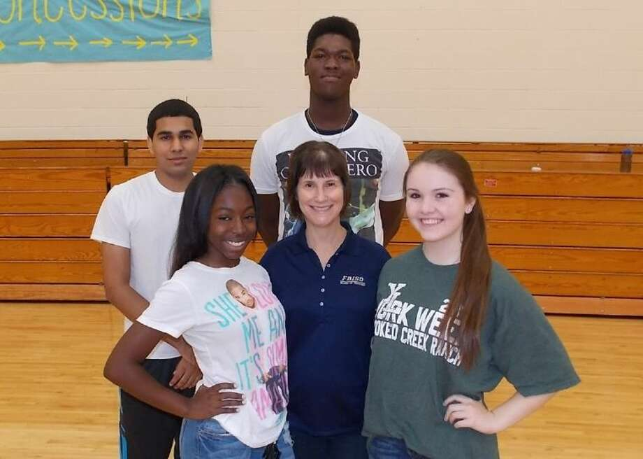 FBISD Board Member Jenny Bailey (center) is shown with Student Leadership 101 cohorts (clockwise, from top) Samuel Awolope (Marshall High School), Shelby Stone (Clements High School) Chasity Henry (Austin High School) and Fahad Noormohammed (Travis High School). Photo: Courtesy FBISD