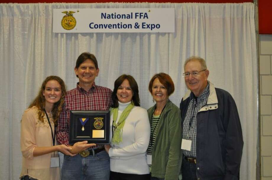 From left, Kelly Fowlkes with her parents, Steve and Trina, and grandparents, Barbara and Marvin Hauck, at the National FFA Convention and Expo, where she and her father earned top awards from the national organization.