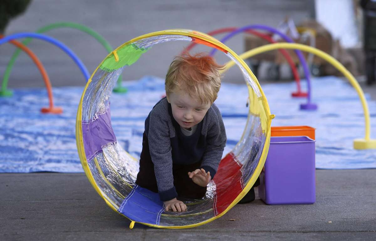 Aidan Byrne, 3 1/2, climbs through an obstacle course at the Maritime Museum at Aquatic Park in San Francisco, Calif. on Saturday, Oct. 1, 2016. The Family Fun Day events, held on the first Saturday of every month, are organized to encourage children and families to get outdoors and be active.