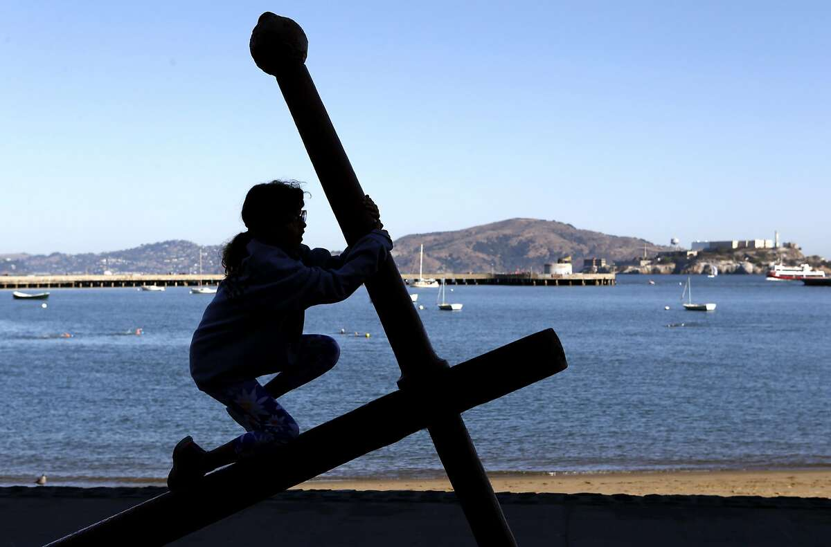 Cleo Morris, 9, climbs on a large ship's anchor at the Maritime Museum at Aquatic Park in San Francisco, Calif. on Saturday, Oct. 1, 2016. The Family Fun Day events, held on the first Saturday of every month, are organized to encourage children and families to get outdoors and be active.