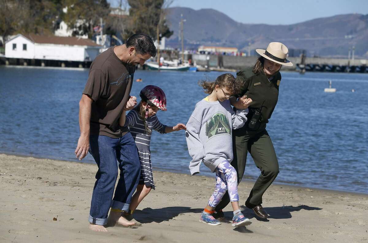 Visiting from Tucson, Ron Elmer and his daughter Sophia, 7, go up against Cleo Morris, 9, and park ranger Lucien Sonder in a three-legged race at the Maritime Museum at Aquatic Park in San Francisco, Calif. on Saturday, Oct. 1, 2016. The Family Fun Day events, held on the first Saturday of every month, are organized to encourage children and families to get outdoors and be active.
