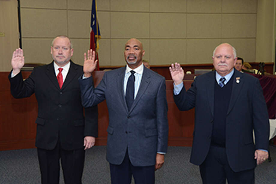 Board members (from left) Don Ryan, Dr. John Ogletree Jr. and Bob Covey take the oath of office for Positions 6, 5 and 7, respectively, during a special-called meeting on Thursday.