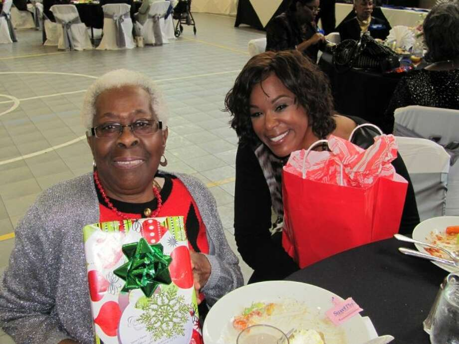 Essie Toliver, left, with KHOU 11's Deborah Duncan at a luncheon Wednesday recognizing 2013 volunteers in the Foster Grandparent Program, which is sponsored locally by the Evelyn Rubenstein Jewish Community Center. Photo: Robin Foster