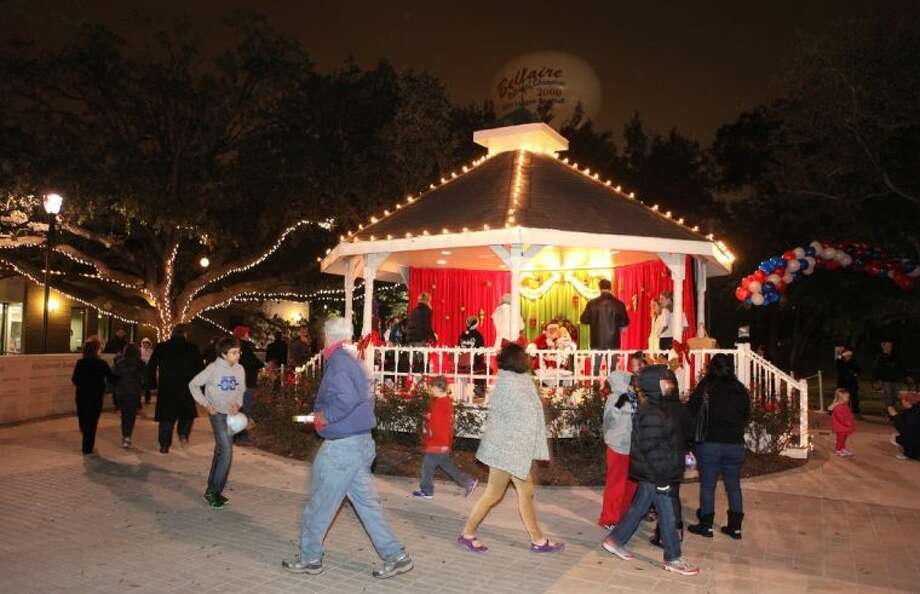 Alight for the holidays, the gazebo at Bellaire Town Square was the place to be for children with wish lists to share during Santa's visit at Holiday in the Park on Thursday, Dec. 5. Photo: Photo By Alan Warren