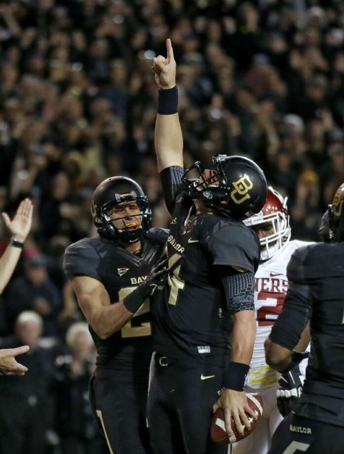 Baylor quarterback Bryce Petty celebrates after running for a touchdown against Oklahoma on Nov. 7 in Waco. The Bears won, 41-12.