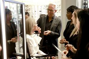 Make up artist Tim Quinn works with Elizabeth Light on Sat. Oct. 1, 2016, in San Francisco, California. Quinn, an internationally renowned makeup artist for Giorgio Armani, comes to do a day of beauty consultations with customers at Saks Fifth Ave. in Union Square.