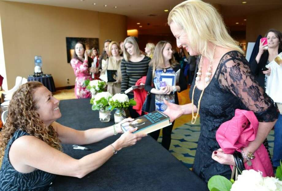 Author Jodi Picoult autographs Spring resident Monica Erickson's book at Friday's John Cooper School Signatures Author Series luncheon at The Woodlands Waterway Marriott Hotel and Conference Center.