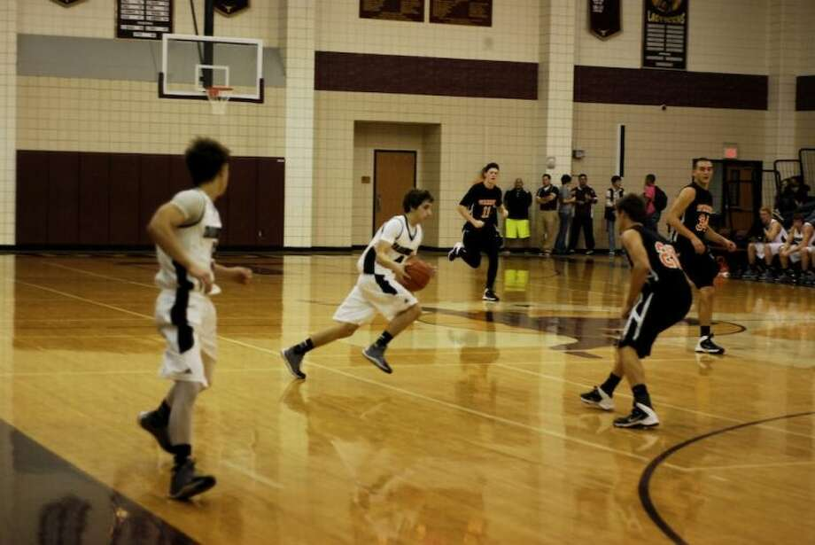 With apologies for a bad pun, Tarkington's Austin Martin (4) deserves to be called Aston Martin for the speed and maneuverability he displayed in the Dec. 3 game against Warren. Photo: CASEY STINNETT