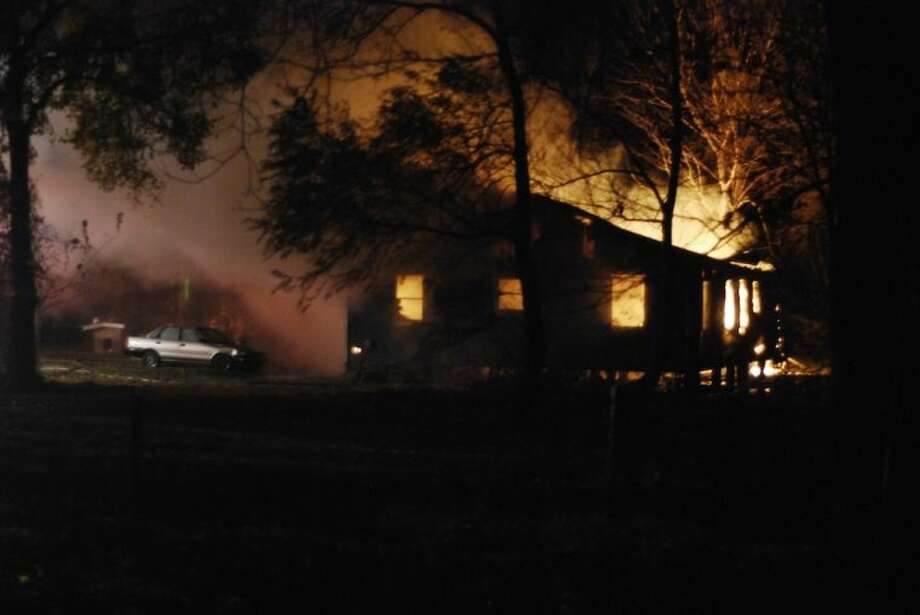House at 873 CR 2094 caught fire around 11 p.m. Friday night, Dec. 6. The cause is not yet known. Photo: CASEY STINNETT
