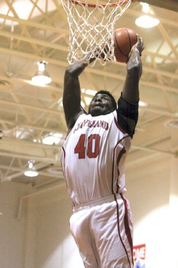 "No one is in the way of Cedric Gambrell (40) of Cleveland and this slam dunk shot. File it under: ""The train is coming through, get off the tracks."" Gambrell scored 15 to help Cleveland to a 76-69 win over Kountze. Photo: MARK ANDERSON"
