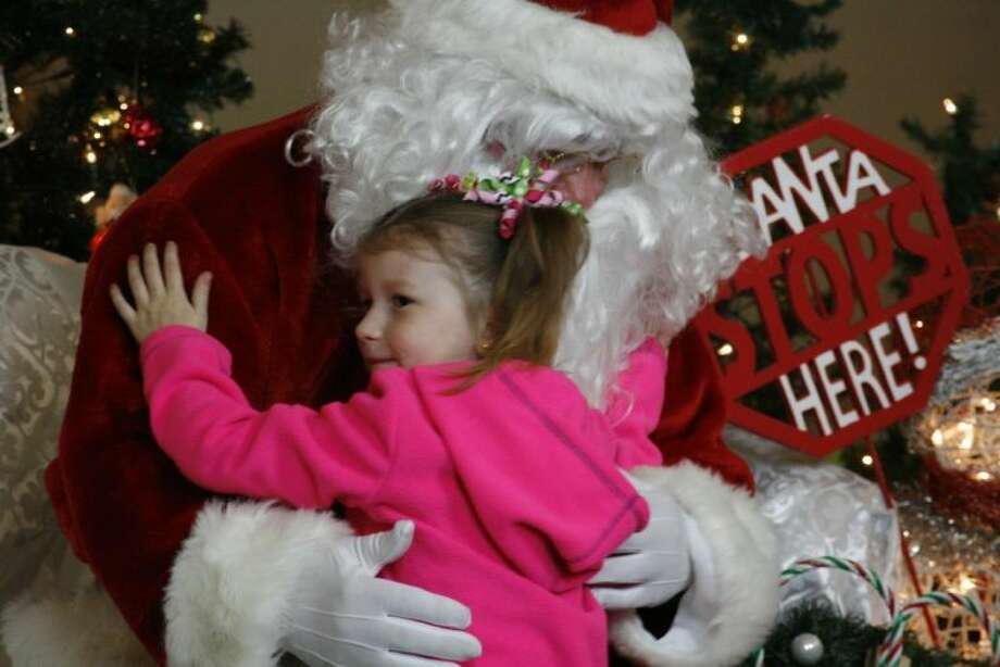 Paityn Steele gives Santa Claus a hug at the annual Atascocita Volunteer Fire Department's Breakfast with Santa Dec. 7, 2013.